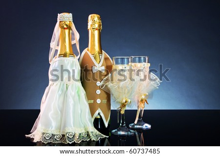 Wedding background of decorated bottles and glasses
