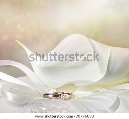 Wedding background with calla lily and golden rings