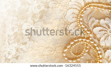 Wedding background with cream silky decoration accessories, lace and pearls with copy space for your text - stock photo