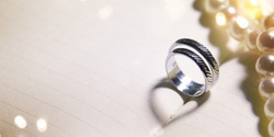 Wedding background with rings and heart shadow