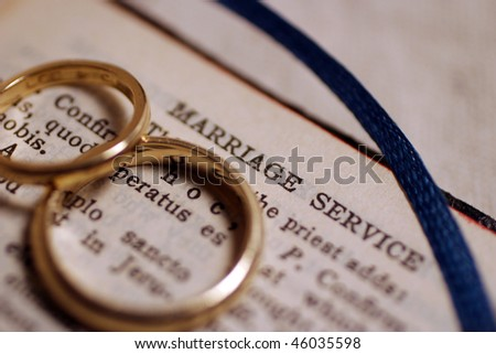 Wedding bands on bible before wedding ceremony.
