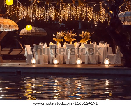 Wedding Banquet or gala dinner decorated with garlands. Festive table set up decor for wedding, party or event #1165124191