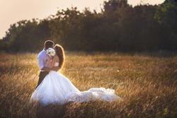 wedding. beautiful couple kissing in the sun