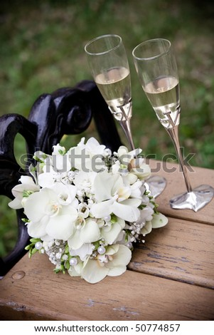 stock photo Wedding bouquet and glasses of champagne