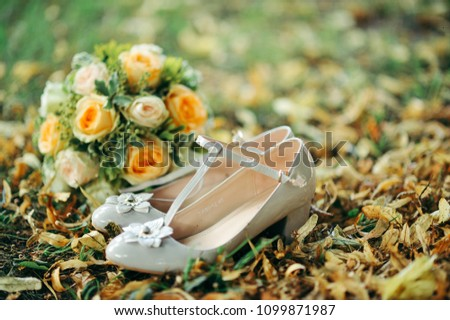 Wedding bouquet and shoes #1099871987