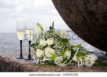 stock photo wedding bouquet and two champagne glasses outdoors