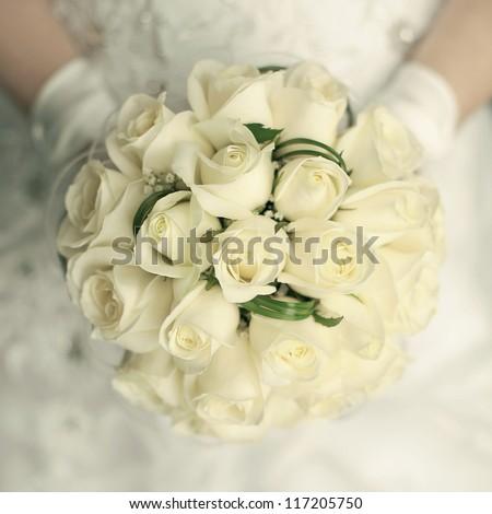 wedding bouquet at bride's hands. studio shot