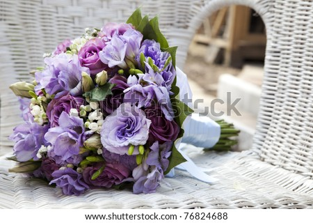 wedding bouquet at chair