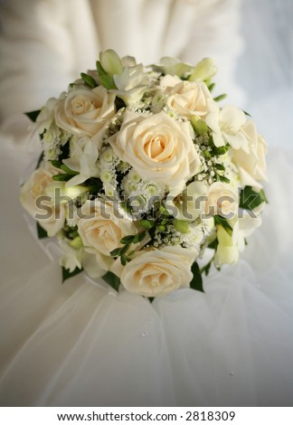 stock photo Wedding bouquet from beige roses on a background of a wedding