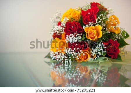 stock photo Wedding Bouquet from red and yellow roses