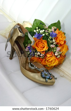 stock photo Wedding bouquet from yellow roses both dark blue a flowers and