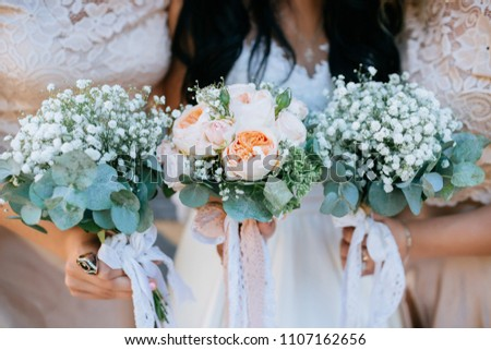 Wedding bouquet holding bridesmaids #1107162656