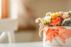 wedding bouquet in a box on a blurred light background with space for text