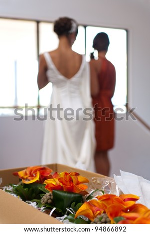Wedding bouquet in foreground and Bride behind out of focus