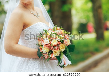 wedding bouquet in hands of bride in the Park #632597990