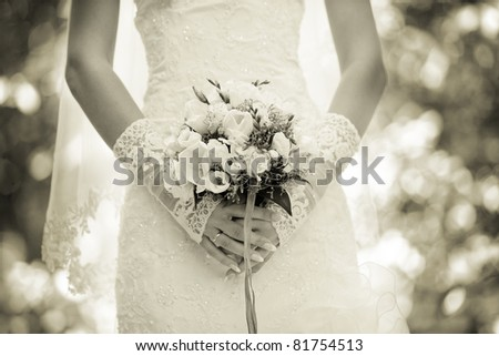wedding bouquet in the hands of the bride - stock photo