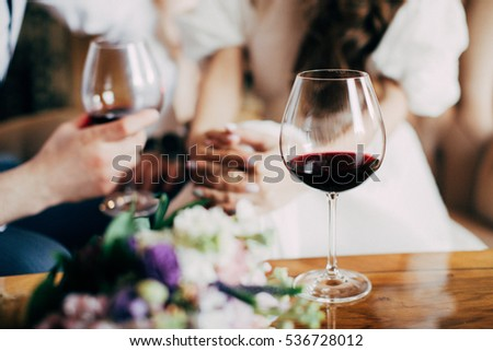 Wedding bouquet near to glass of red wine #536728012