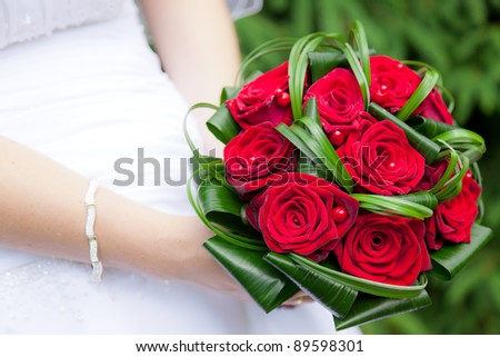 Wedding bouquet of bride's hands