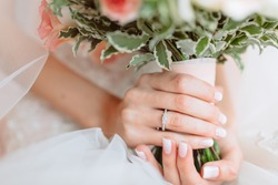Wedding bouquet of flowers in brides' hands