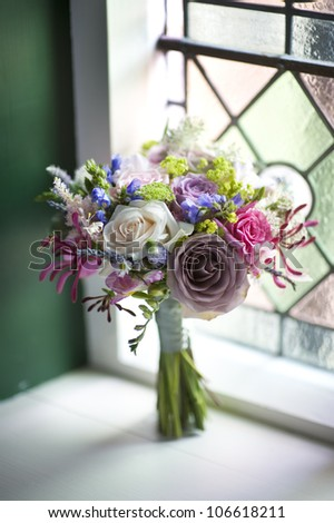 wedding bouquet of flowers near a window