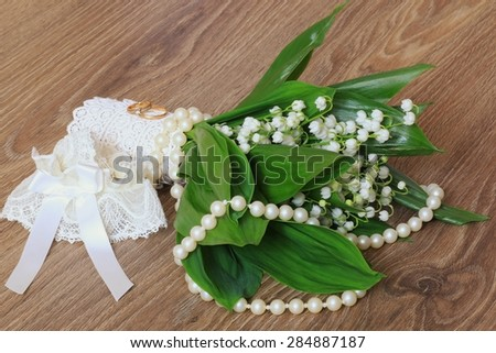 Wedding bouquet of lilies of the valley accessory ring