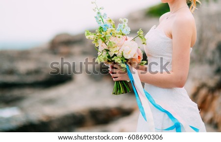 Wedding bouquet of peonies in the hands of the bride. Wedding in Montenegro. #608690306