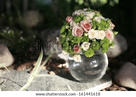 Wedding bouquet of pink and white roses in the glass sphere , wedding bouquet
