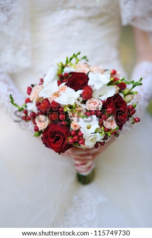 wedding bouquet of red and white flowers - stock photo