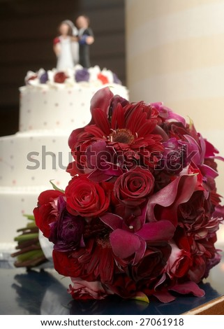 stock photo Wedding bouquet of red roses at reception table