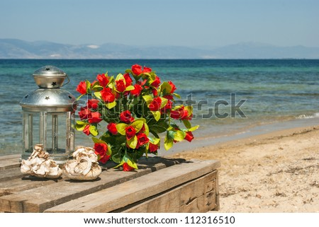 Wedding bouquet of roses on the beach - stock photo