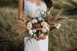 wedding bouquet of the bride, boho style, outdoor, dry flowers