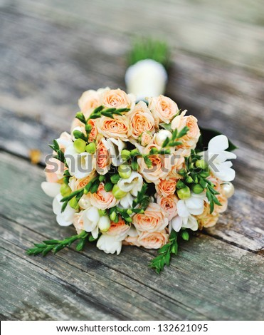 Wedding bouquet on a wood surface