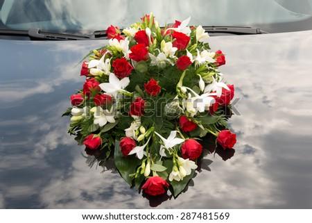 stock-photo-wedding-bouquet-on-car-287481569.jpg