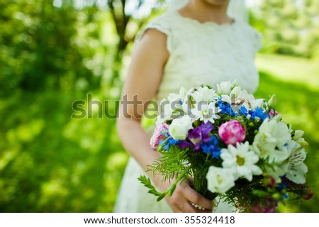 Wedding bouquet on hand of bride #355324418