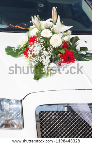 wedding bouquet on limo car in marriage day