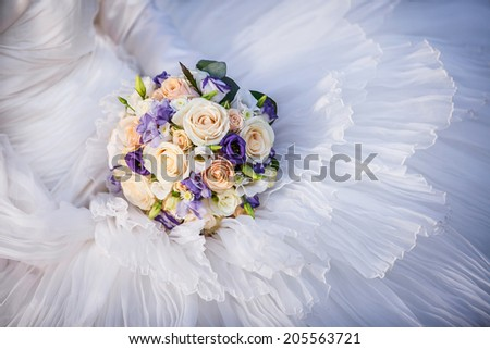 Wedding bouquet on the dress