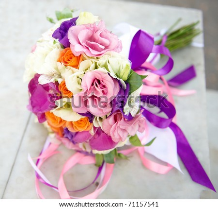 Wedding bouquet tied with silk ribbons