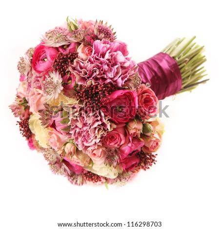wedding bouquet with Astrantia, Skimma, Brassica, rose bush, Ranunculus asiaticus, cloves,