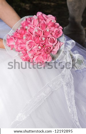 stock photo Wedding Bouquet with pink roses and pearly beads