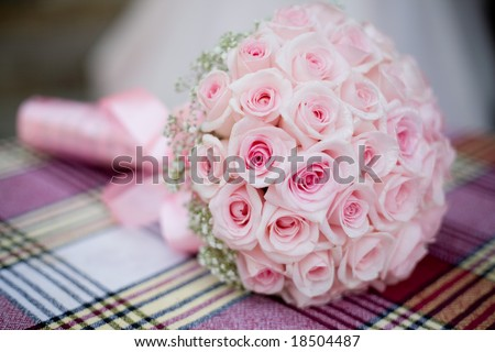 stock photo Wedding bouquet with pink roses on checkered backdrop
