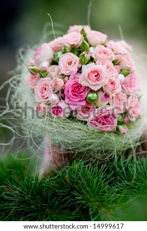Wedding bouquet with pink roses on pine branch