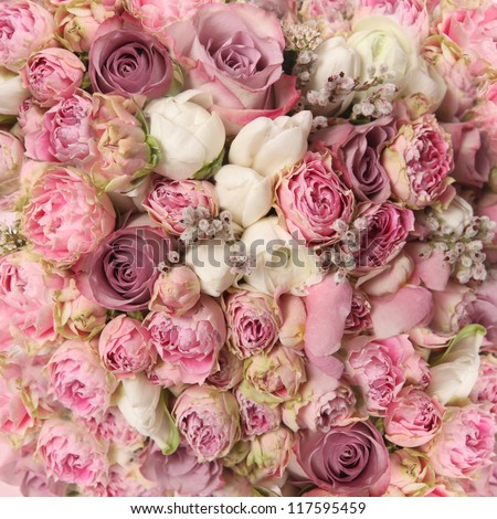 wedding bouquet with rose bush Ranunculus asiaticus as a background