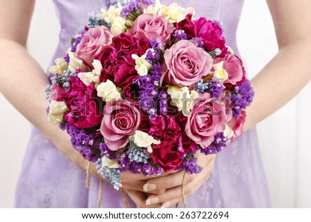 Wedding bouquet with roses and carnations