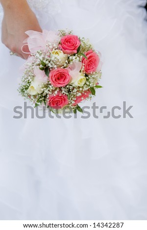 Wedding bouquet with roses in bride's hand
