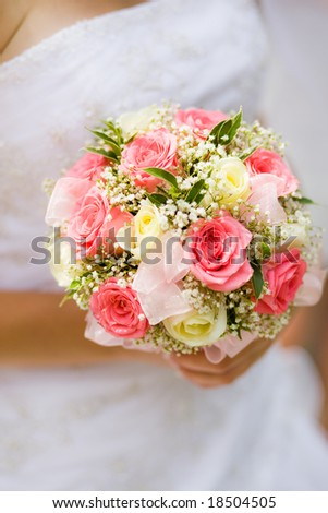 stock photo Wedding bouquet with white and pink roses in bride hand