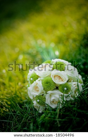 stock photo Wedding bouquet with white roses in fresh green grass