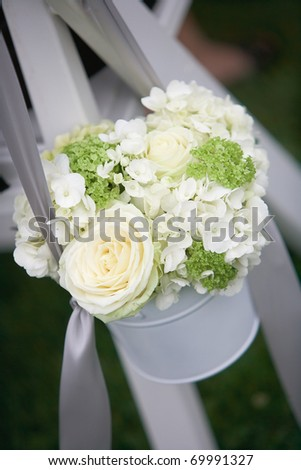 Wedding bouquets of roses at outside ceremony