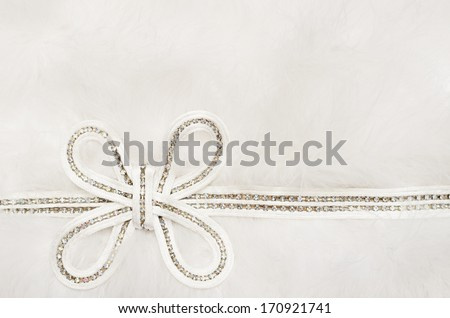 Wedding bow on swansdown background