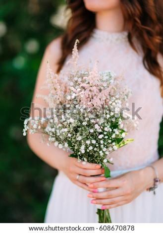 Wedding bridal bouquet of Gypsophila in the hands of the bride. Wedding in Montenegro. #608670878