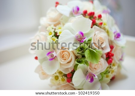 wedding bridal bouquet with white orchids, roses, daisies and red berries